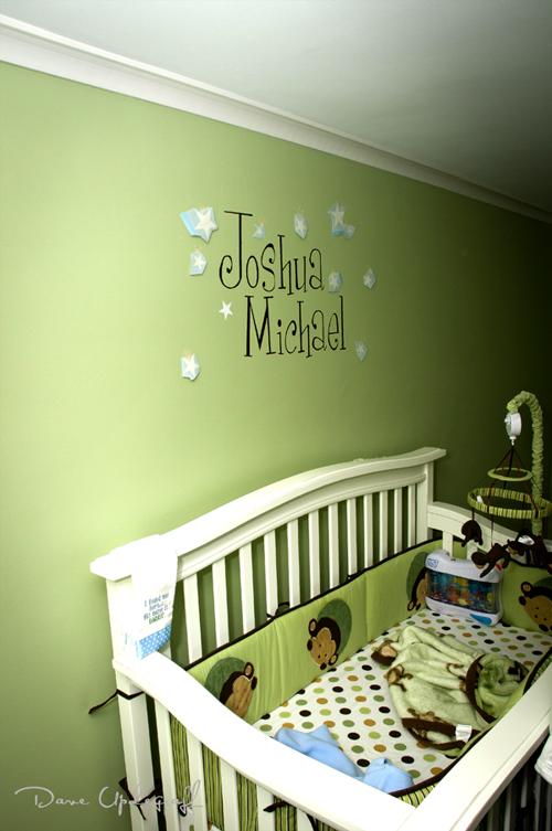 Josh's name over his crib