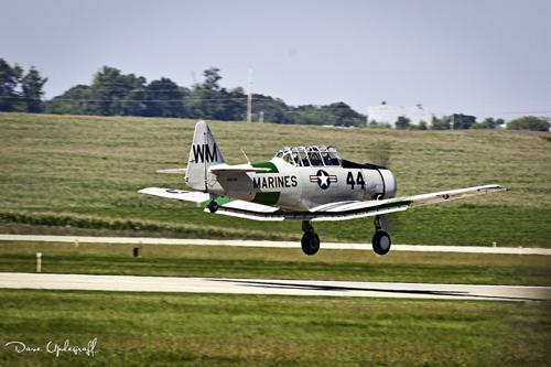 T-28 lifts off the runway at DBQ