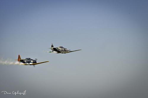 A pair of T28s over fly the DBQ airport