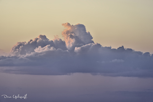 Clouds bathed in setting sunlight