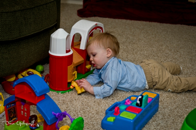 Joshua plays with his toy farm