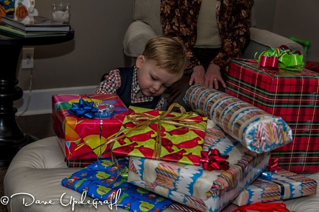 Joshua examines his presents