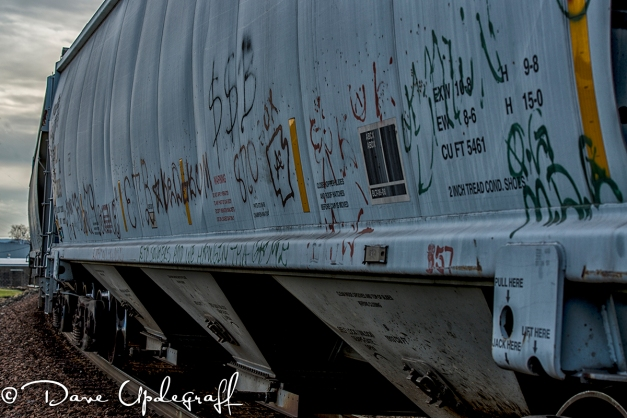 Graffiti on the side of a railroad car