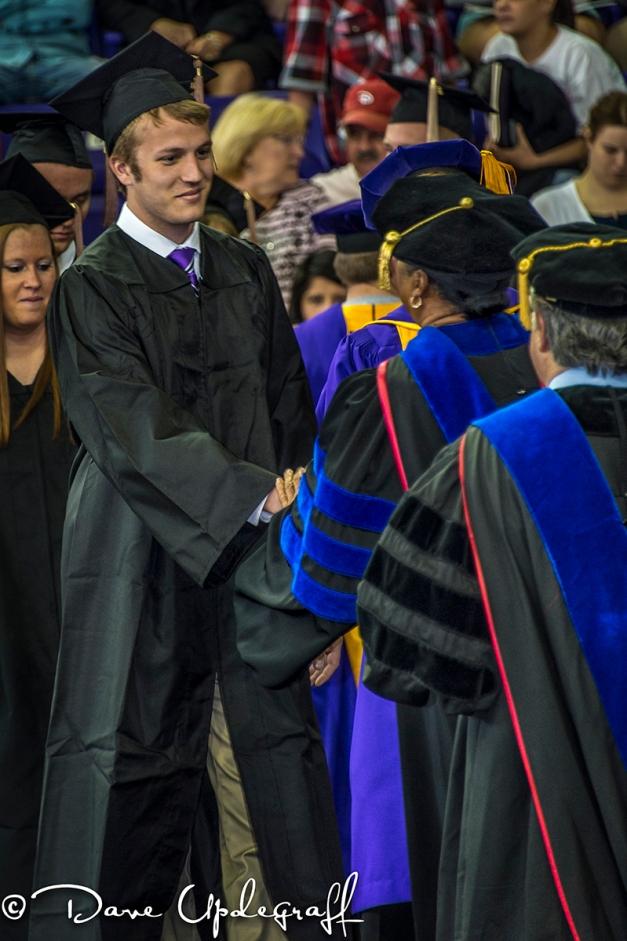 Mark receives his diploma