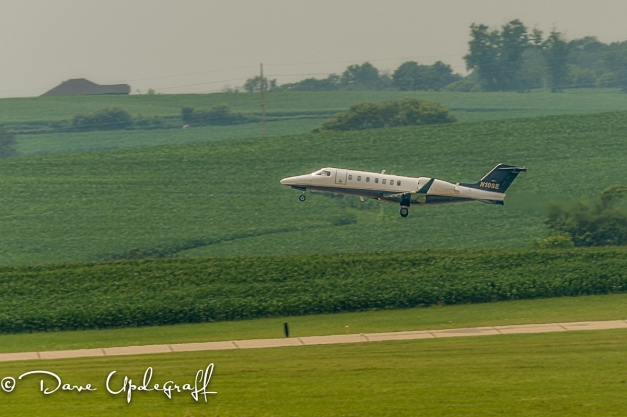 A small corporate jet takes off
