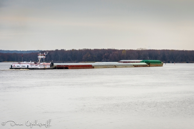 A barge moves down river
